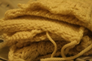 Pile of cream knitted swatches